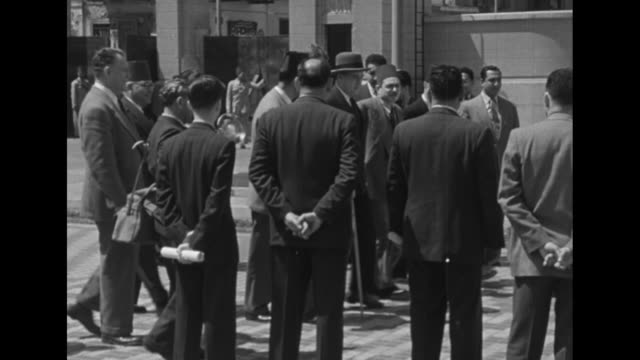 ambassador jefferson caffery gets out of pontiac automobile, greeted by egyptian officials and industrialists / entourage enters building / entourage... - ambassador stock videos & royalty-free footage