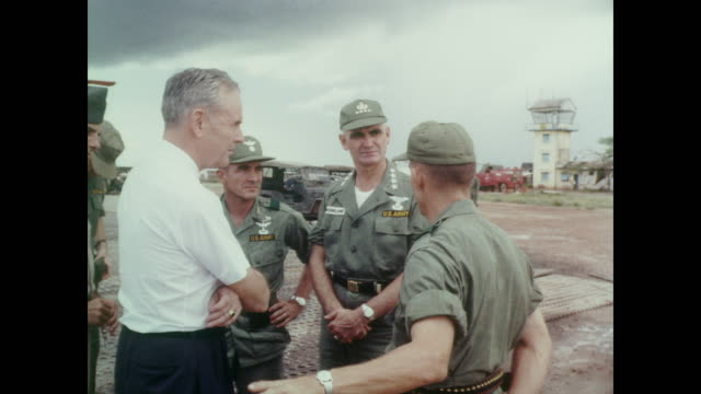Ambassador Maxwell D Taylor and General William Westmoreland discuss the damage after a Vietcong attack at Bien Hoa Air Base