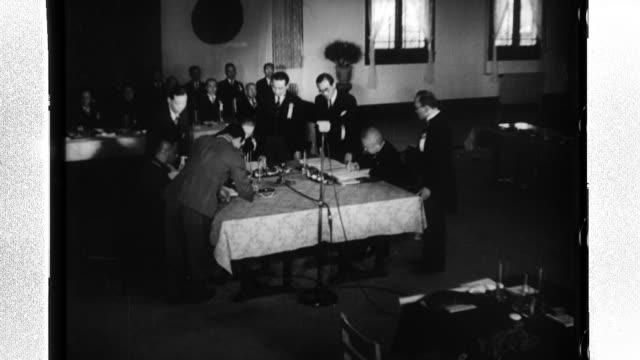 Ambassador Nobuyuki Abe of Japan Wang Zhaoming President of Nationalist China and a representative of Manchukuo sign the Threenation joint...
