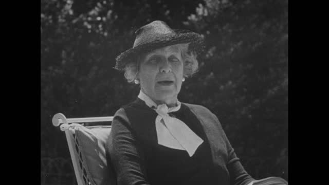 ambassador to norway florence jaffray harriman leaves her residence's door and she sits on a bench with her german shepard / she explains her agenda... - newsreel stock videos & royalty-free footage