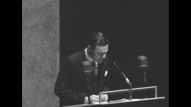 Ambassador to UN Henry Cabot Lodge Jr standing at podium speaking about staffing of UN delegations / Note exact day not known