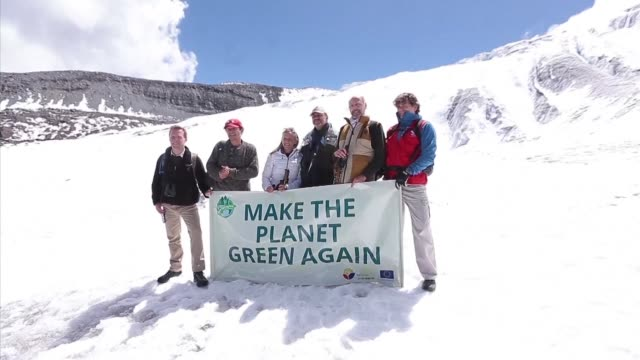 ambassadors and meteorologists symbolically climbed ecuador's antisana volcano whose glacier is melting at an alarming rate to ask the world to unite... - paris agreement stock videos & royalty-free footage