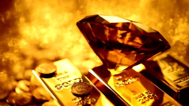 amber diamond und gold-dateien (endlos wiederholbar) - barren geld und finanzen stock-videos und b-roll-filmmaterial