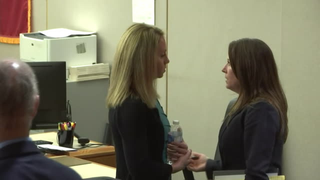 amber guyger talks with a woman in the courtroom during her murder trial in dallas, texas. - crime or recreational drug or prison or legal trial点の映像素材/bロール