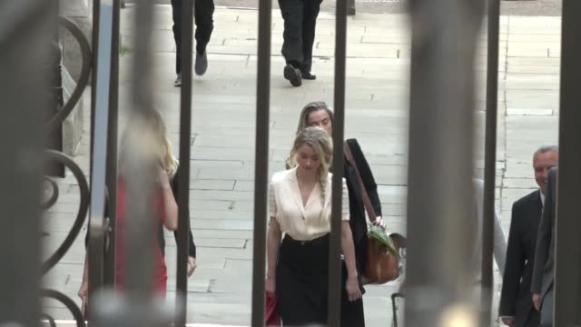 amber heard arriving at high court in london to give evidence against johnny depp in his libel case against the sun newspaper - justice concept stock videos & royalty-free footage