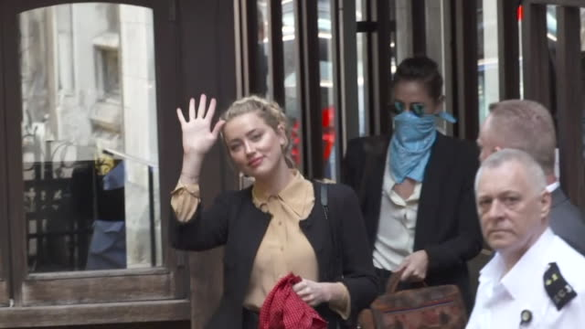 amber heard arriving at high court to give evidence against ex-husband johnny depp in his libel case against the sun newspaper who labelled him a... - label stock videos & royalty-free footage