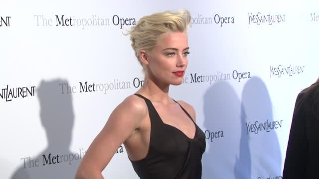 "vídeos de stock, filmes e b-roll de amber heard at metropolitan opera gala premiere of jules massenet's ""manon"" at the metropolitan opera house on march 26, 2012 in new york, new york - manon lescaut"