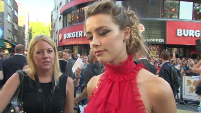 INTERVIEW Amber Heard on her stage fright on Channing Tatum being a good dancer if she likes muscle men at 'Magic Mike XXL' European Film Premiere at...