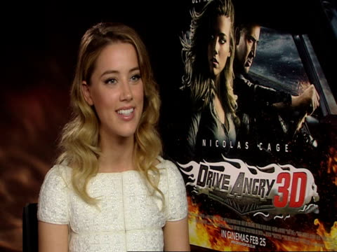 amber heard on working with nicolas cage at the drive angry interview at london england. - nicolas cage stock videos & royalty-free footage