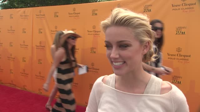 Amber Heard talks seeing her first polo match and her love of horses at the The Fourth Annual Veuve Clicquot Polo Classic at New York NY