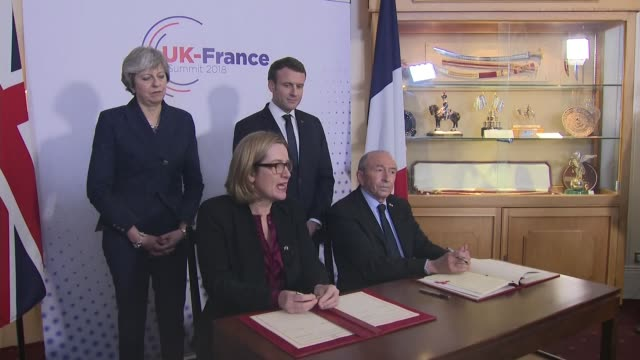 amber rudd and gerad collomb sign 'sandhurst treaty' england berkshire sandhurst int theresa may mp and emmanuel macron stand as amber rudd mp and... - minister president stock videos and b-roll footage