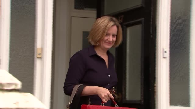 London EXT Amber Rudd MP from house and responding to questions SOT / into car and away