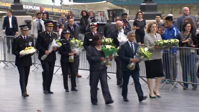 Amber Rudd Sadiq Khan Diane Abbot and religious leaders leaving flowers during a vigil for victims of the London Bridge terror attack