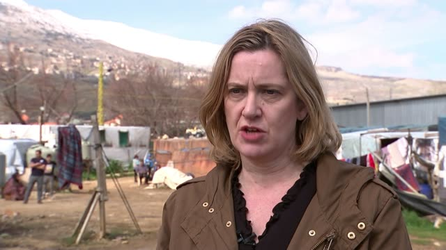 Amber Rudd visits Lebanese refugee camp Beqqa Zahle District Qab Elias EXT Wide shot mountain with snow on peak Children playing on tricycle in...