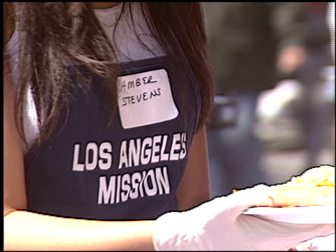 amber stevens at the homeless easter at los angeles mission on march 25, 2005. - amber stock videos & royalty-free footage