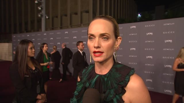 amber valletta on what brings her out, the significance of art and film at lacma and her thoughts on the honorees. wearing gucci at lacma hosts 2012... - アンバー ヴァレッタ点の映像素材/bロール