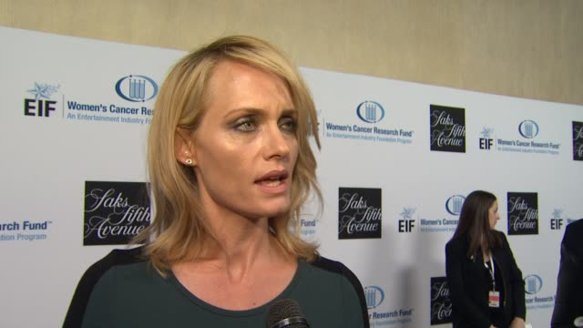 amber valletta on what brings her out tonight why she's chosen to get involved in the fight against women's cancer and if she has a personal... - amber valletta stock videos and b-roll footage