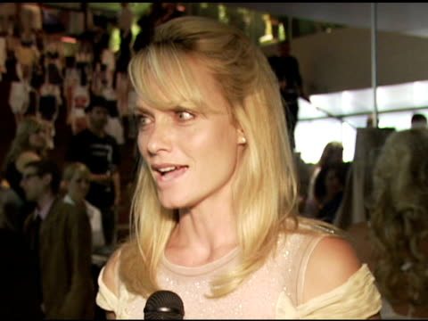 amber valletta wearing prada on knowing miuccia prada on why she wears prada on how she loves the handbags on her outfit at the los angeles opening... - バレッタ点の映像素材/bロール