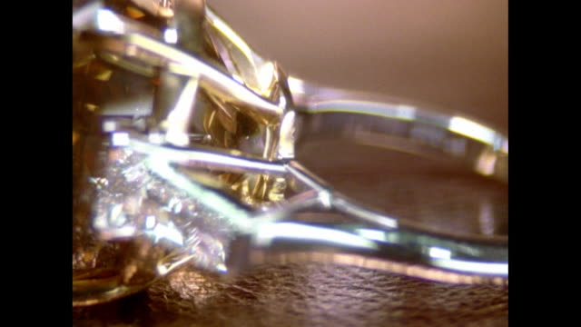ecu amber-colored ring in silver band turning on tabletop / new york, usa - silver metal stock videos and b-roll footage