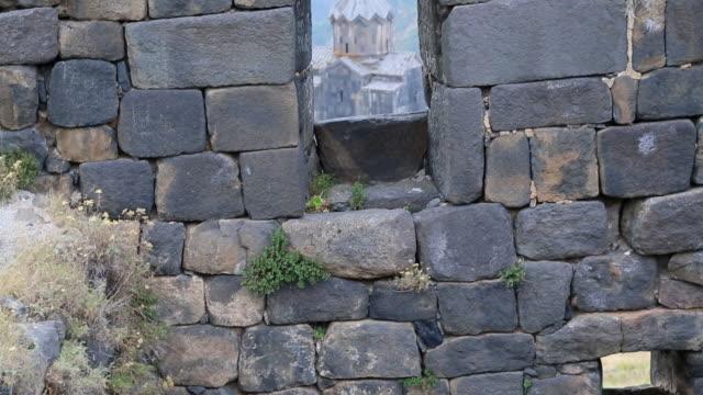 vídeos de stock e filmes b-roll de amberd castle, view of vahramashen church from the castle - por volta do século 11 dc