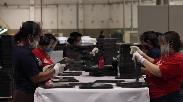 ambev pioneers in diverting from its core business to produce face shield masks to be donated to hospitals amidst the coronavirus pandemic general... - anheuser busch inbev stock-videos und b-roll-filmmaterial
