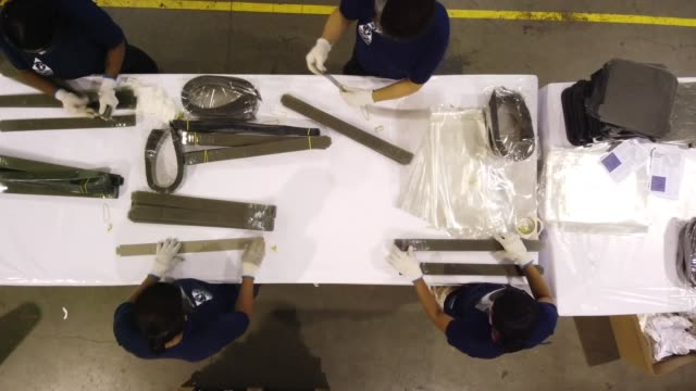 ambev pioneers in diverting from its core business to produce face shields aerial views of workers and ambev/bizsys manufacturing facilities for face... - anheuser busch inbev stock-videos und b-roll-filmmaterial