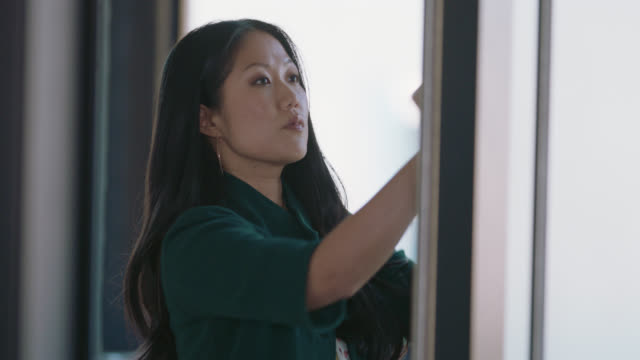 ambitious businesswoman scans and rearranges notes on whiteboard - sales occupation stock videos & royalty-free footage