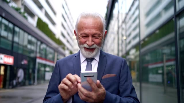 ambitious modern senior ceo looking how his stock shares raising on a stock market - grey hair stock videos & royalty-free footage