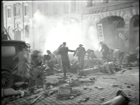 1947 reenactment ambulance and rescue personnel rushing through street under bomb attack / united kingdom - home guard britannica video stock e b–roll