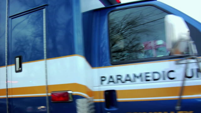 MS Ambulance arriving on scene, paramedics getting out, New London, Wisconsin, USA