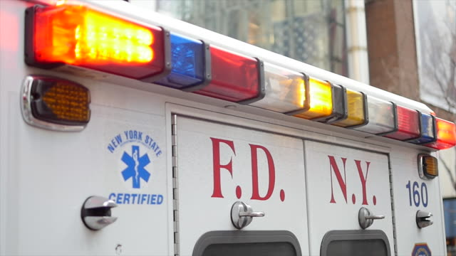 ambulance car standing on street in new york city. emergency service vehicle. public safety background - fire department of the city of new york stock videos and b-roll footage