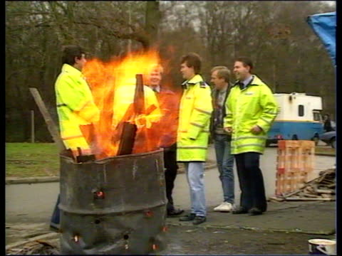 possible strike call picket line by brazier - streikposten stock-videos und b-roll-filmmaterial