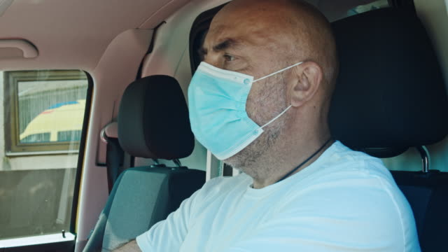 slo mo ambulance driver getting into the vehicle - autista mestiere video stock e b–roll