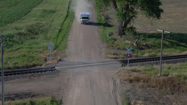 ambulance driving across railroad tracks on a gravel road - nebraska stock videos & royalty-free footage