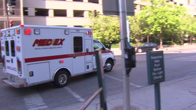 ambulance driving away at lurie children's hospital on june 11 2013 in chicago illinois - children's hospital stock videos & royalty-free footage