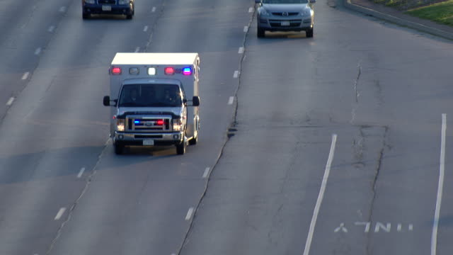 Ambulance driving down a multi-lane highway