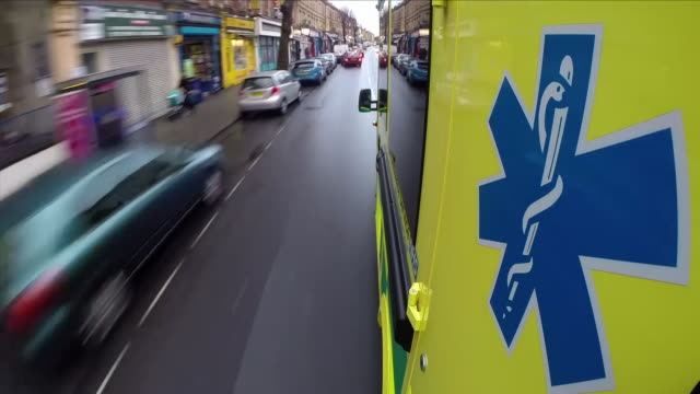 Ambulance driving down a road