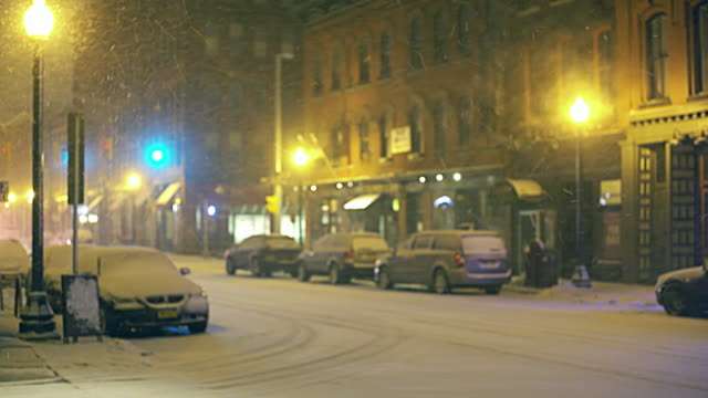 ambulance driving on the street under snowfall - syracuse stock videos & royalty-free footage