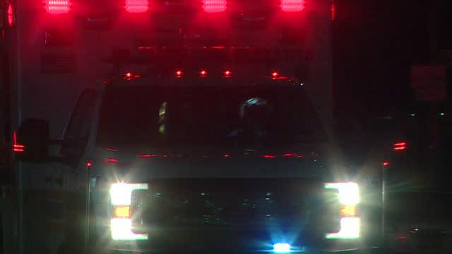 ambulance driving through new york streets with sirens blaring during coronavirus pandemic - blaulicht stock-videos und b-roll-filmmaterial