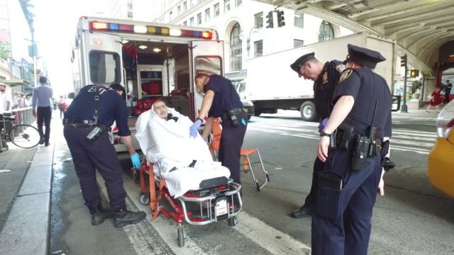 ambulance emergency service and nypd helping patient in new york city - stretcher stock videos & royalty-free footage