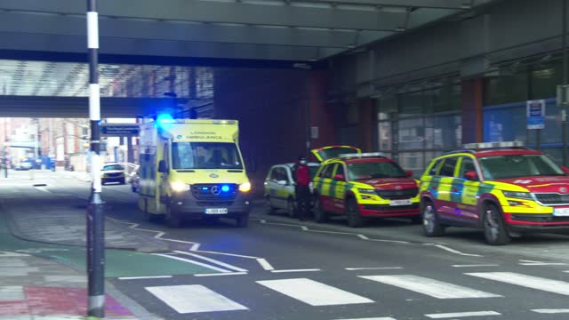 ambulance flashing its blue lights comes in to be a part of a line of ambulances outside the royal london hospital in east london on january 3, 2021.... - shape stock videos & royalty-free footage