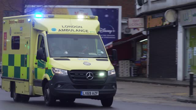 ambulance has its blue lights on as it rushes on a public road on january 12, 2020 in london, england. - land vehicle stock videos & royalty-free footage
