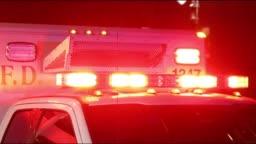 Ambulance lights flashing at night downtown