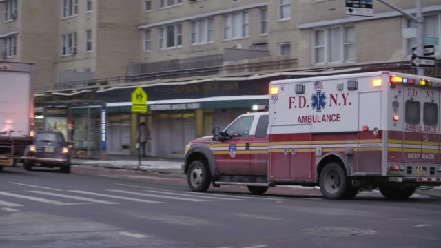 fdny ambulance moves through traffic with sirens on - siren stock videos and b-roll footage
