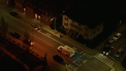 ambulance on city streets at night - massachusetts stock videos & royalty-free footage