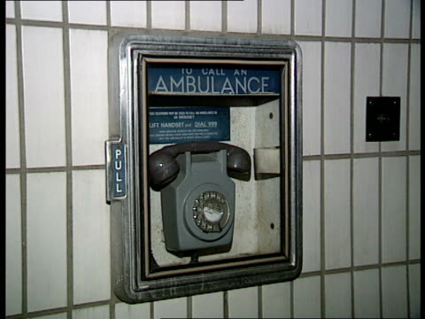 Ambulance overtime ban CR1140 NATIONAL 40 Night Doors of station closed 'London Ambulance London Service' sign Wall mounted ambulance telephone...