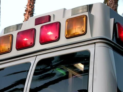 ambulance, rear flashing lights - ambulance stock videos & royalty-free footage