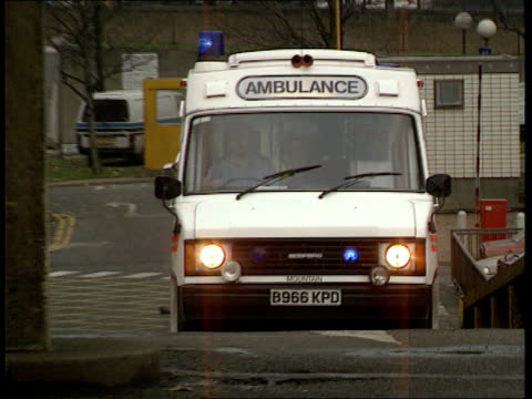 MS Ambulance towards PAN RL with lights flashing as pulls up at hospital NAF
