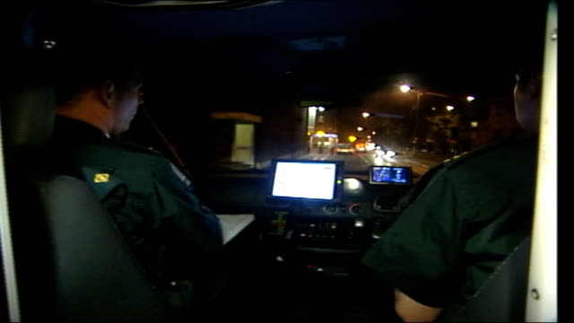 london tonight follow crew itn england london int ambulance driver's pov along road as they answer a 999 call tcms paramedic writing notes in book... - moving after stock videos & royalty-free footage