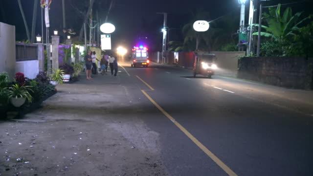 ms ambulance speeding down road at night,sri lanka - on the move stock videos & royalty-free footage